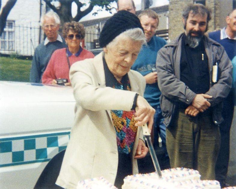 Miss Jean Milburn (1904-2000) cuts the Cake