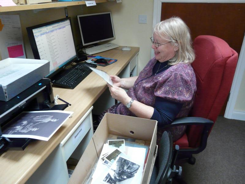 A volunteer working with our collections software