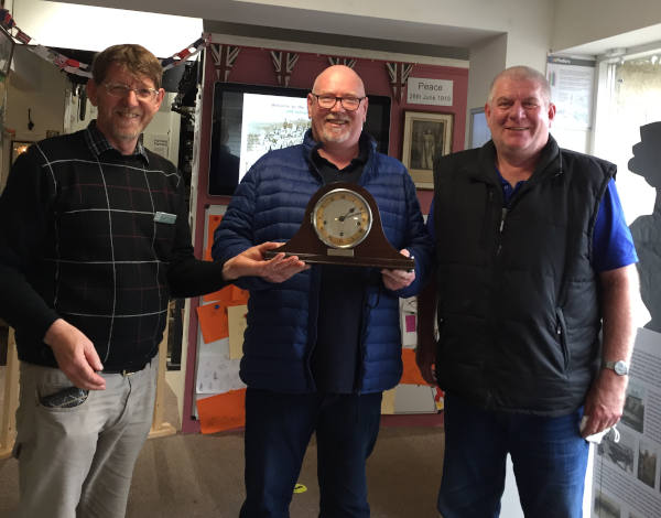 Chairman Steve Gibbon with bothers Gerry and Kenny Durkin and their Grandfather's clock
